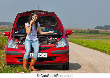 Woman has in her car breaks down. Engine failure - Young ...