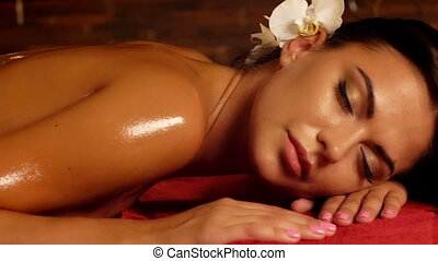 Woman have feet massage in spa salon. - Massage therapy...