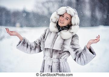 Woman have fun on snow in winter