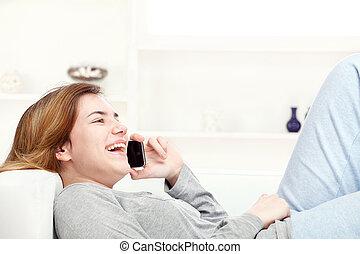 woman have joyful talk over telephone