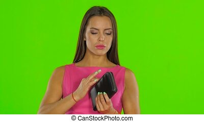 Woman have no money in the wallet. Green screen. Close up -...