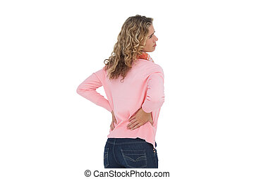 Woman having a back ache and holdin