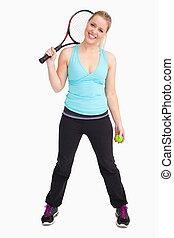 Woman having a ball and tennis racquet