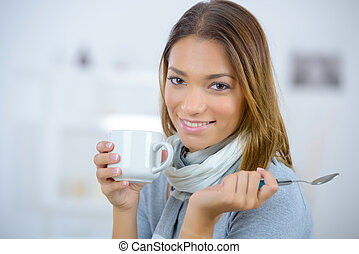 Woman having a coffee at home