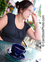 Woman having a coffee