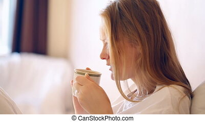 Woman having a cup of hot coffee in the morning