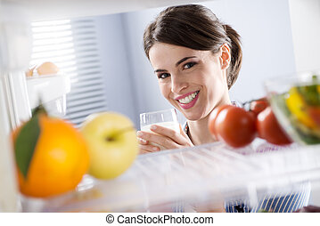 Woman having a glass of milk