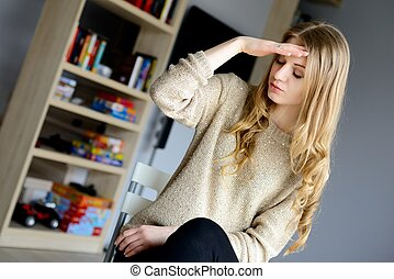 Woman having a headache pain and feeling unwell