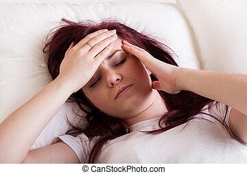 Woman having a headache - Young woman having a headache...