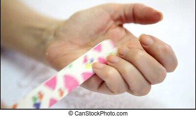 Woman having a manicure