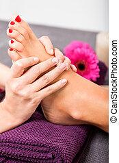Woman having a pedicure treatment at a spa