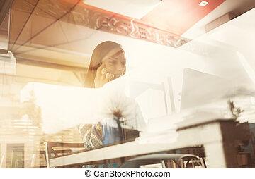 Woman having a phone call at the bar