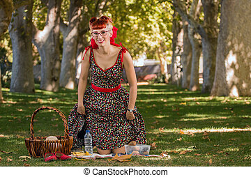 Woman having a picnic in the park.