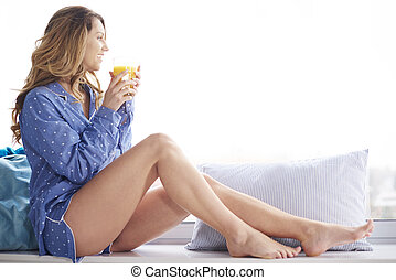 Woman having a rest with glass of orange juice