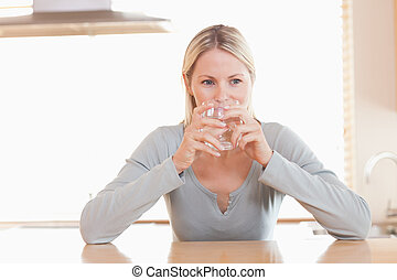 Woman having a sip of water