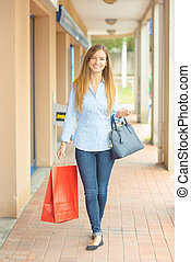Woman having a successful shopping trip