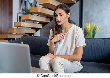 Woman having an online conversation with her therapist