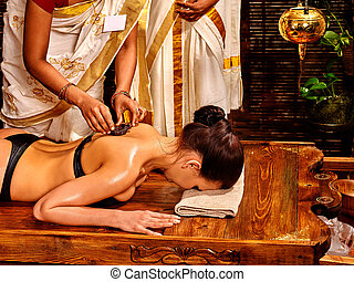 Woman having Ayurvedic spa massage.