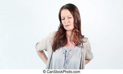 Woman having back troubles