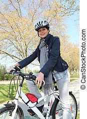 Woman having bike ride