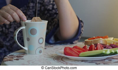 Woman having breakfast at home in the morning, adult woman ...