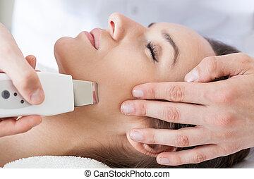 Woman having cavitation peeling - Close-up of woman having...