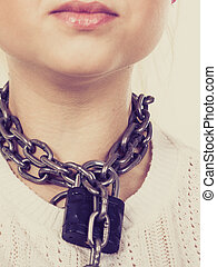 Woman having chain with padlock on neck