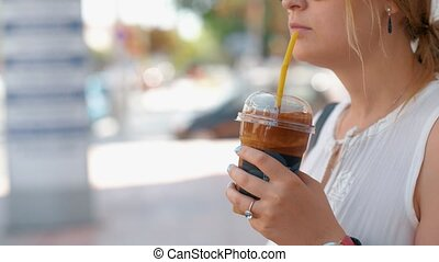 Woman having chocolate drink in the street