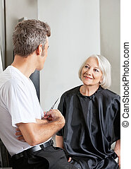Woman Having Conversation With Hairdresser