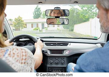 Woman having driving lesson