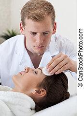Woman having facial cleansing