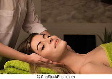 Woman having facial massage - Young woman having a facial...