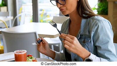 Woman having food in restaurant 4k - Beautiful woman having ...