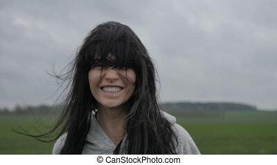 Woman having fun in meadow