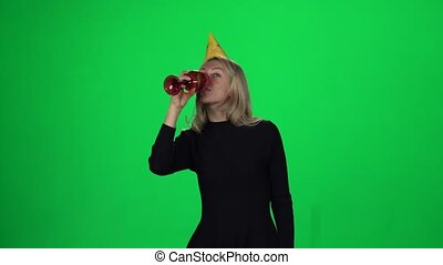 Woman having fun on birthday. Green screen