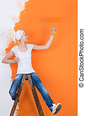 woman having fun while painting