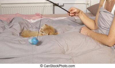 Woman having fun with cat
