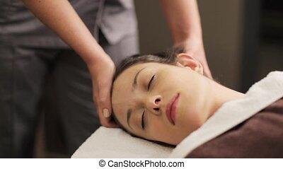 woman having head massage at spa - people, beauty, lifestyle...