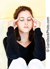 woman having headache at home