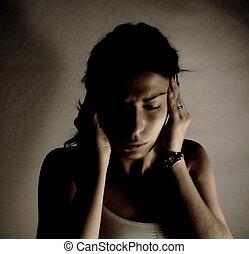 headache - woman having headache, filtered image, dark mood