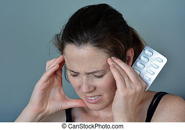 Woman having headache taking pills - Woman (age 30-40)...