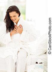 woman having heart attack - young woman in pajamas having...