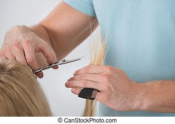 Woman Having Her Hair Cut By Male Dresser