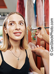 Woman having her make-up done