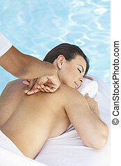 Woman Having Massage By Pool At Health Spa