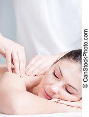 Woman having massage on her shoulder