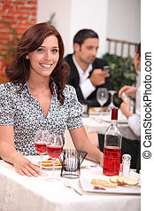 Woman having meal in restaurant