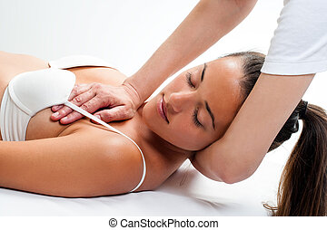 Woman having osteopathic neck massage. - Close up of woman ...