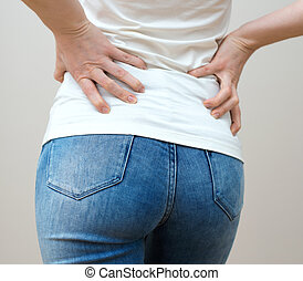 Woman having pain in her back.