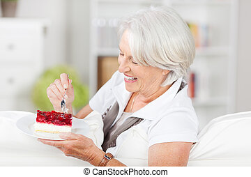 Woman Having Pastry While Sitting On Sofa